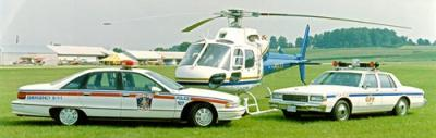 two police cruisers and helicopter from early 1990s