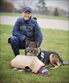 Contable McMichan and police service dog Magnum